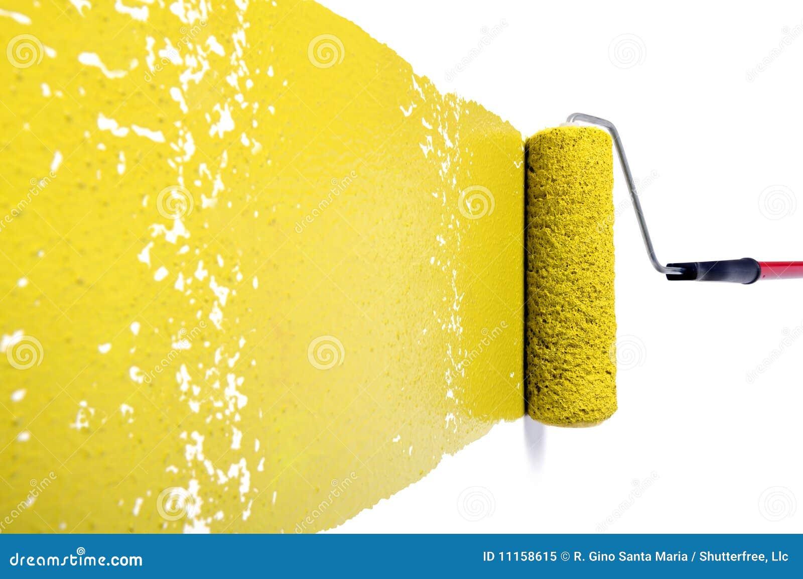 Rolo com pintura amarela na parede branca imagem de stock - Pintura metalizada para paredes ...