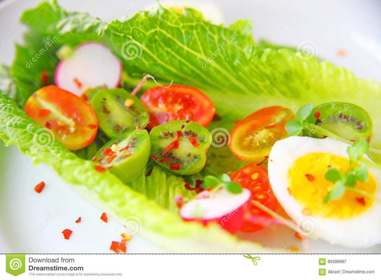 Romaine lettuce with baby kiwis and cherry tomatoes