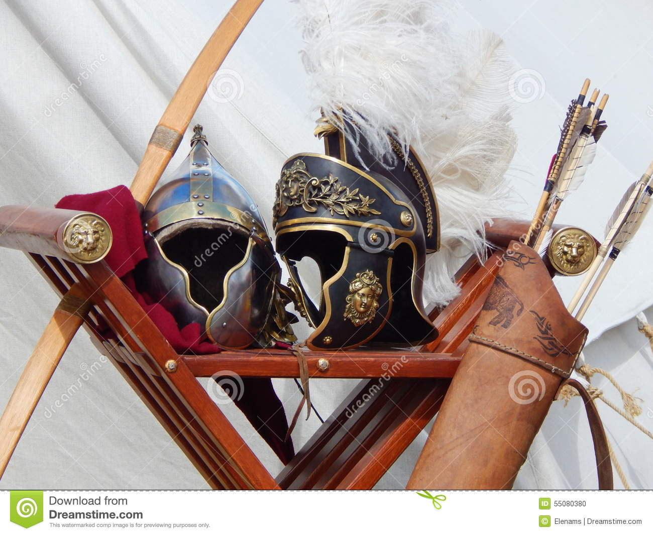 Roman helmets, bow and arrows at the international festival Times and epochs. Ancient Rome