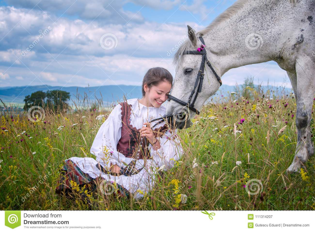 Romania beautiful girl and traditional costume in summer time and beautiful Arabian horse