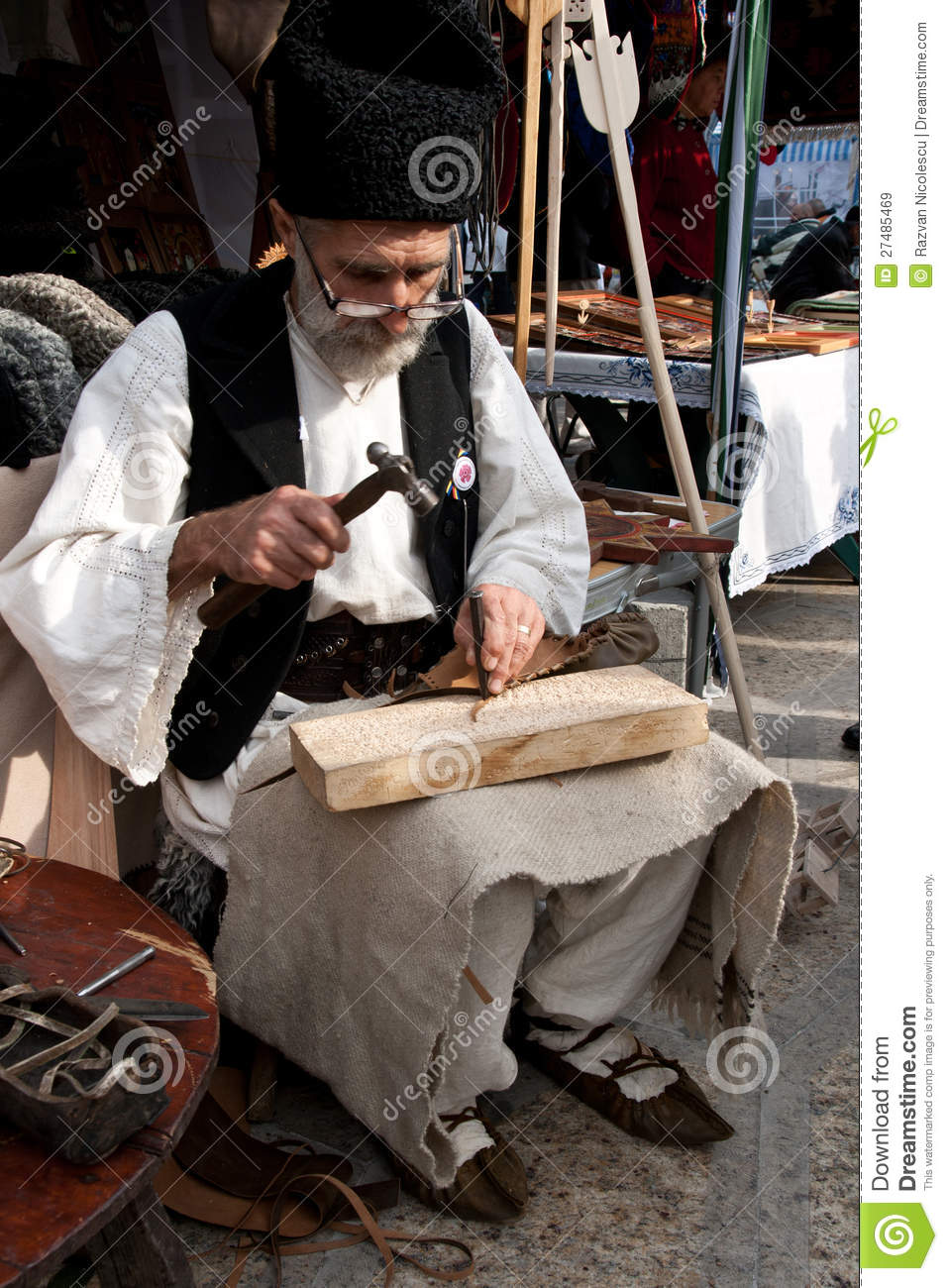 sandal maker Romanian traditional sandal maker Editorial Stock Image
