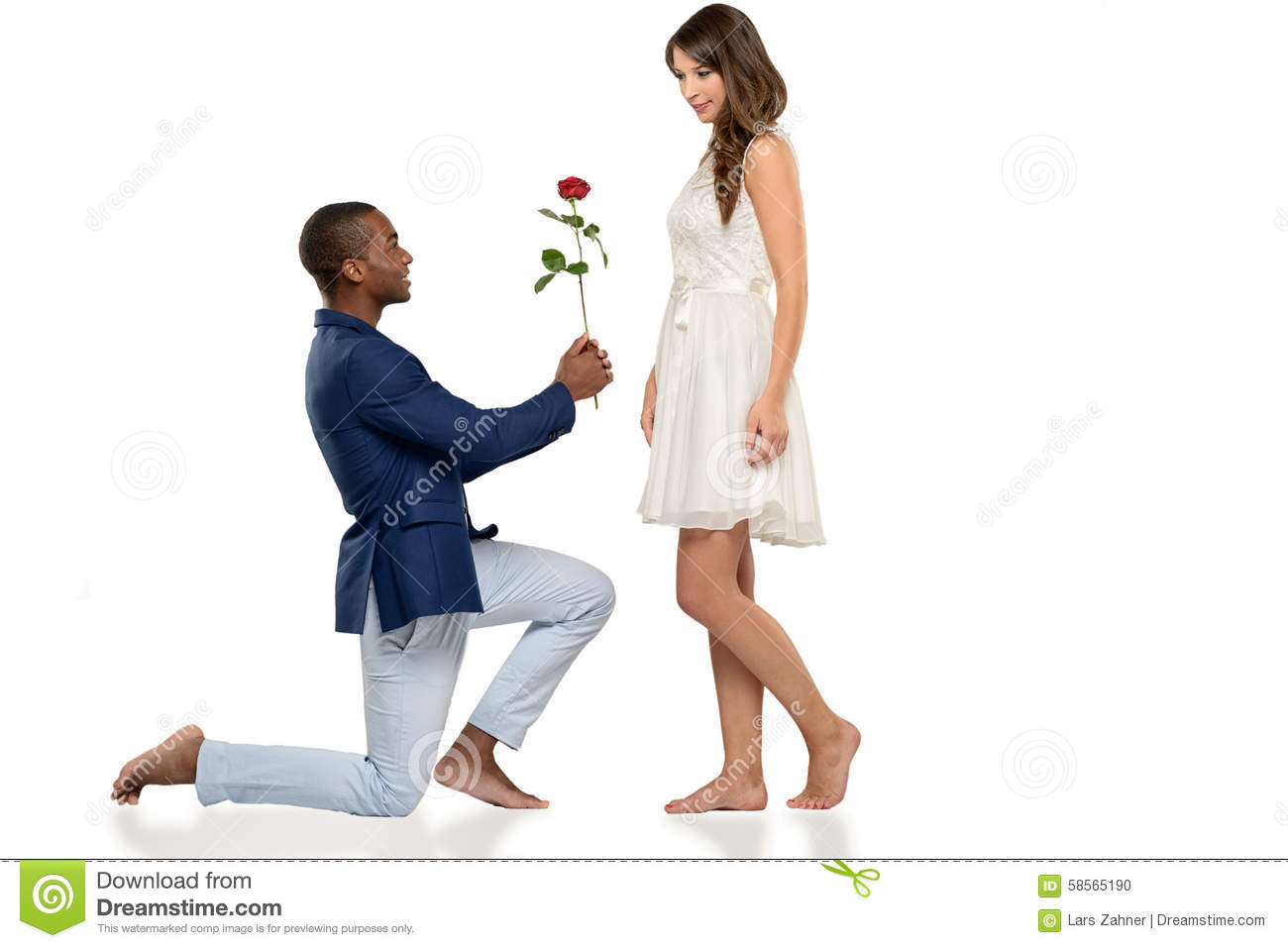 Romantic Barefoot Man Proposing To His Love Stock Photo