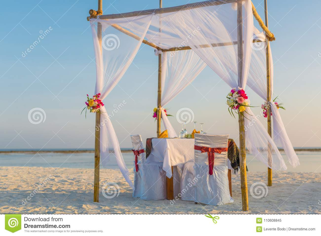 Romantic Beach Wedding And Wedding Arch Background Concept Stock