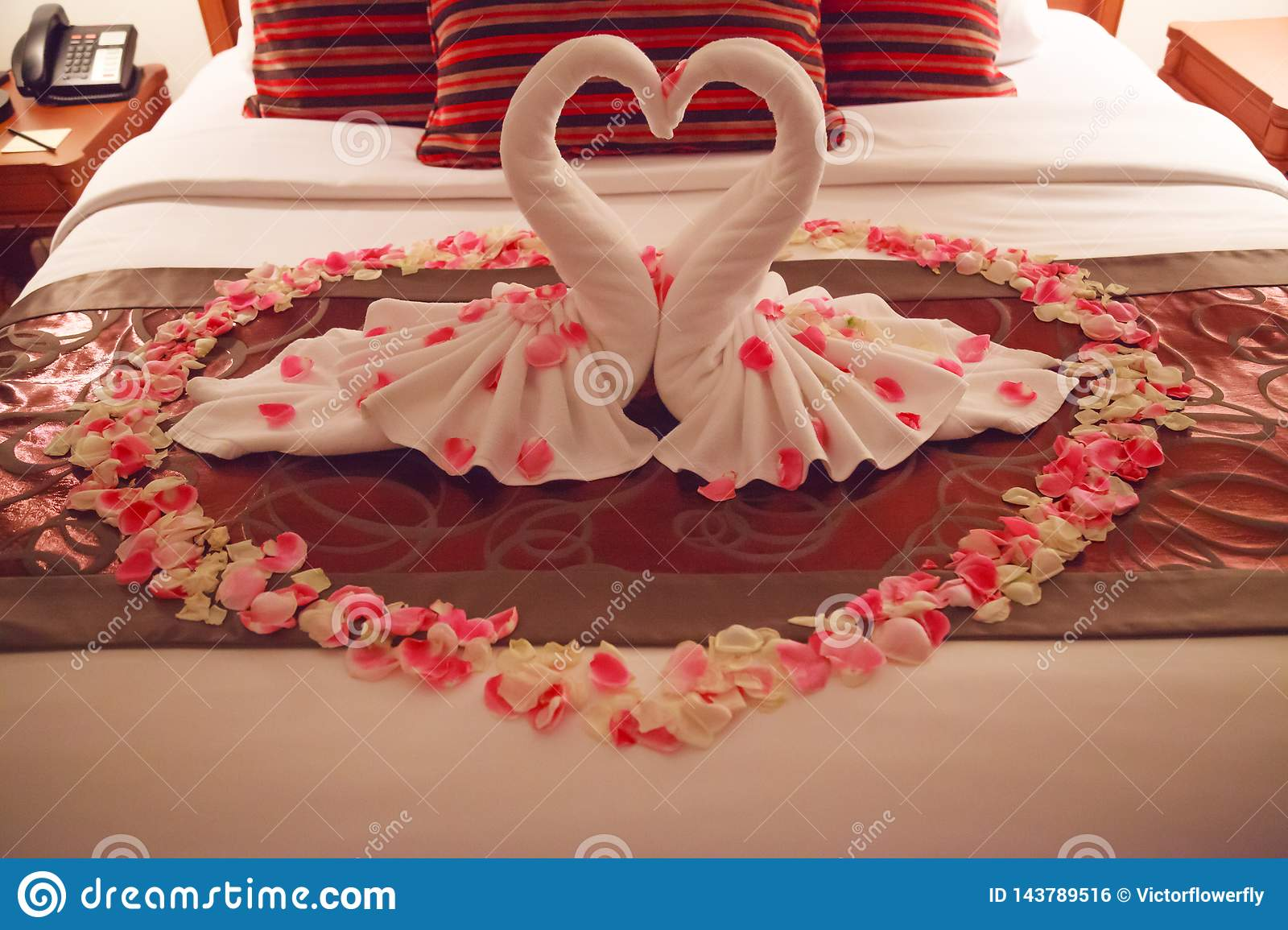 Romantic Bedroom Interior Kissing Swan Origami Towels And Sprinkled Fresh Pink White Rose Flower Petals Decoration On Bed For Stock Photo Image Of Craft Floral 143789516