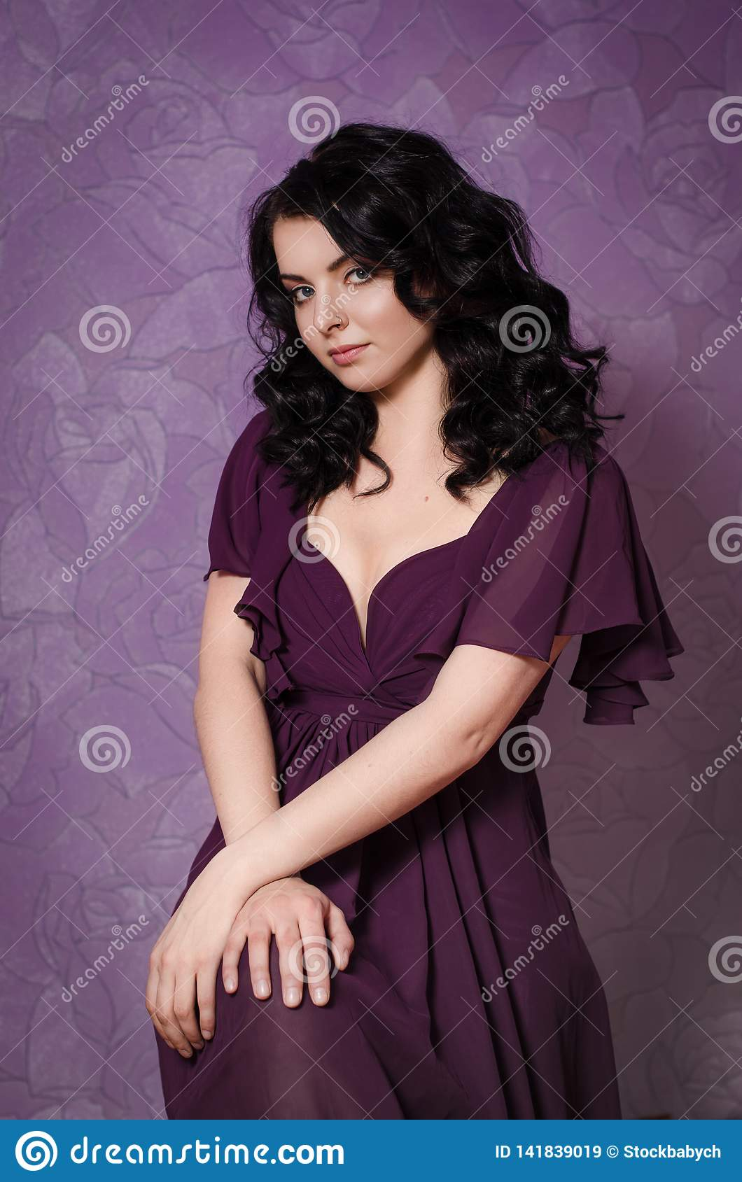 Romantic brunette girl with curly hair