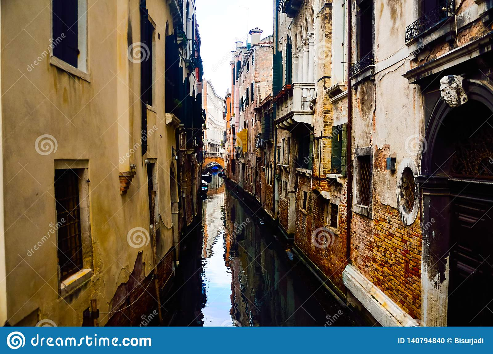 Small tight canal at romantic city of Venice