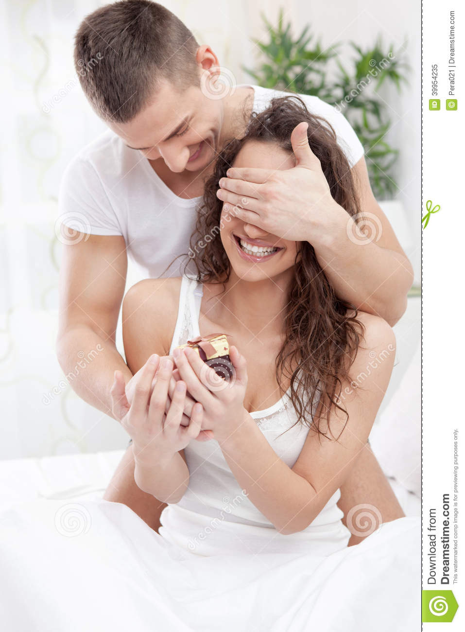 Romantic couple in bed with gifts stock image image of boyfriend romantic couple in bed with gifts negle Images