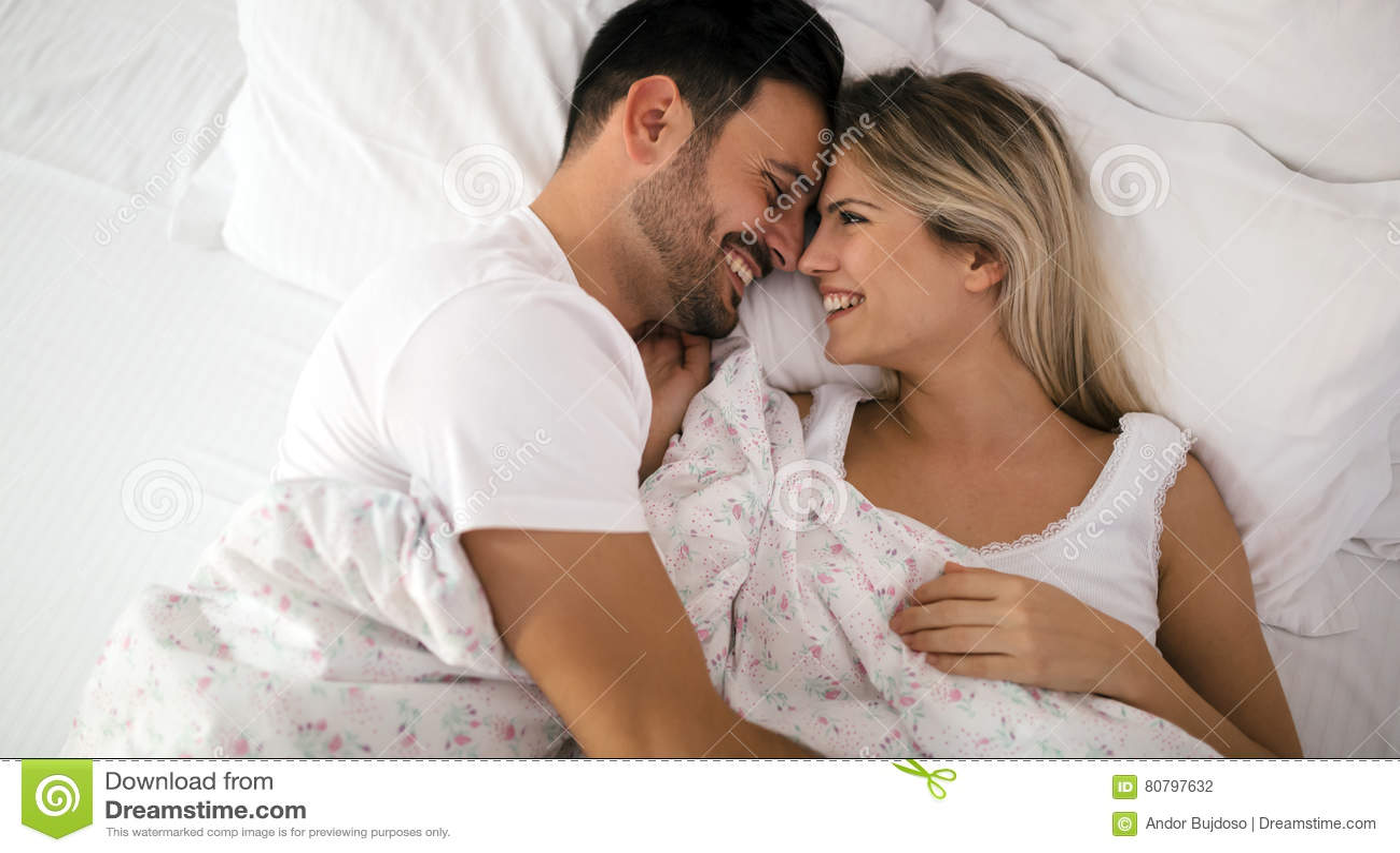Romantic couple in bed in nightwear. Romantic Couple In Bed In Nightwear Stock Photo   Image  80797632