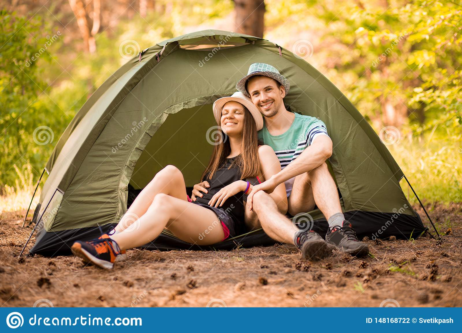 Romantic Couple Camping Outdoors And Sitting In Tent ...