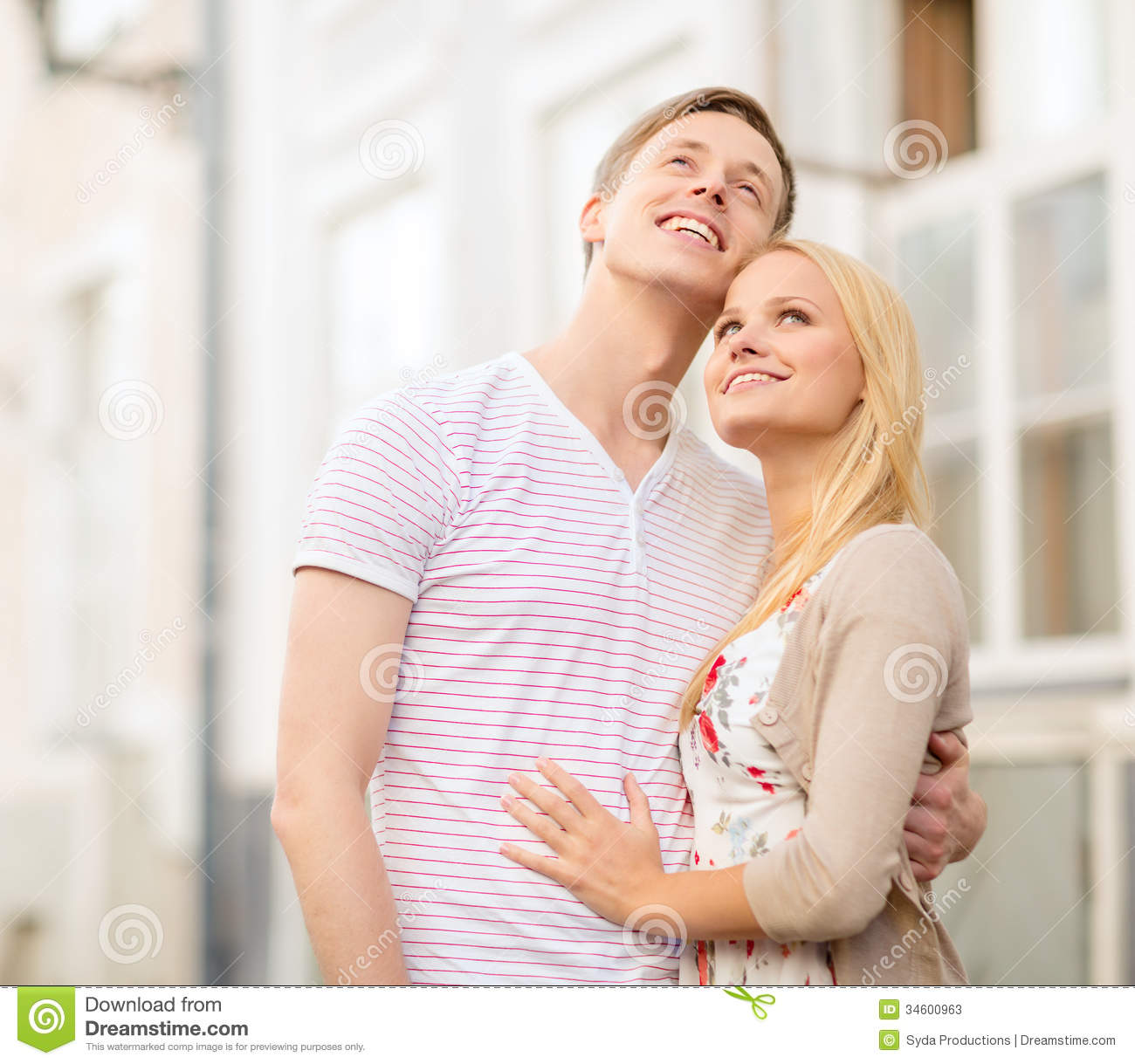 Couple Enjoying Their Summer Holidays Stock Photo: Romantic Couple In The City Looking Up Stock Image