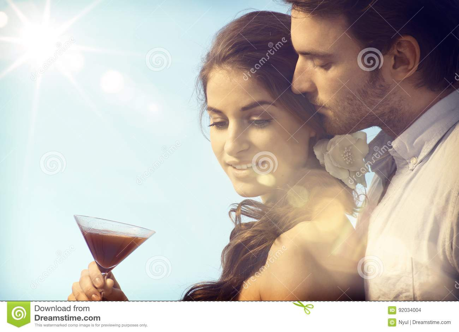 Romantic couple drinking in sunset