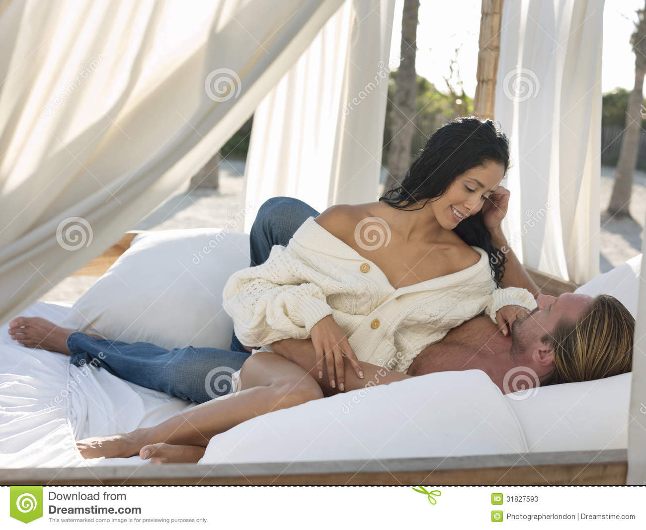 Romantic couple in four poster bed