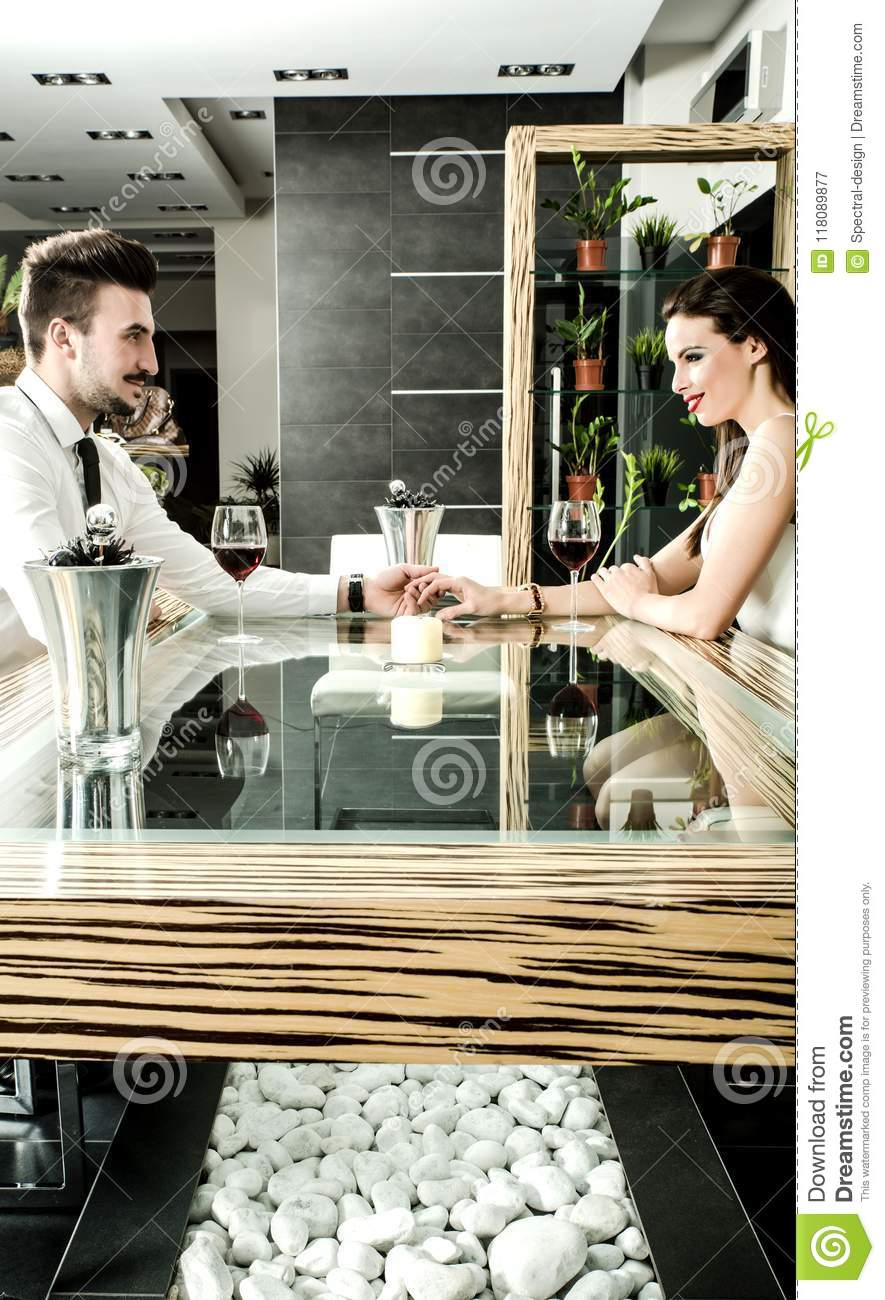 Romantic Dining Room: A Romantic Couple With A Glass Of Wine In The Dining Room