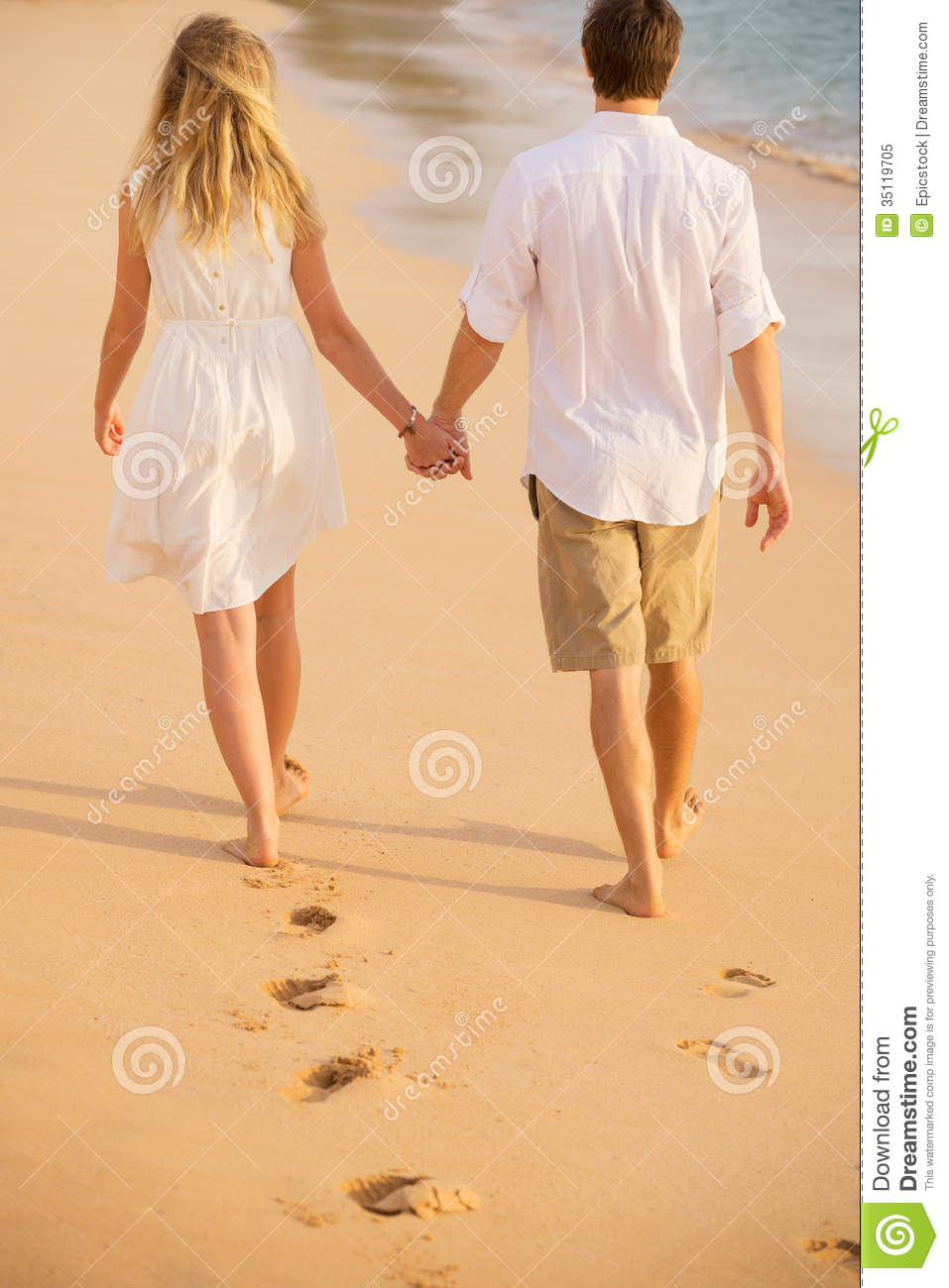 Romantic Couple Holding Hands Walking On Beach At Sunset Royalty Free ...