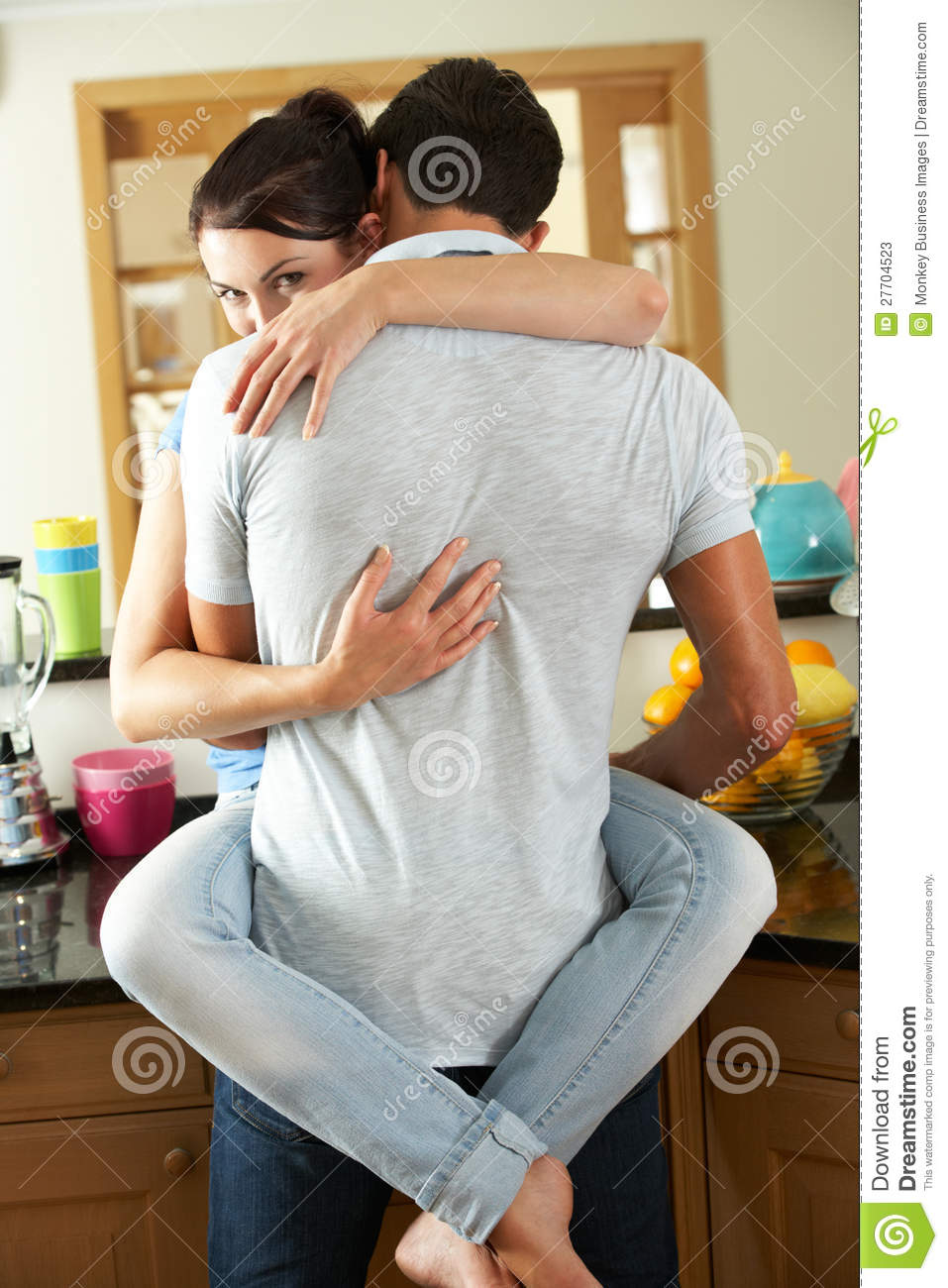 Romantic Couple Hugging In Kitchen Stock Image - Image of female ...