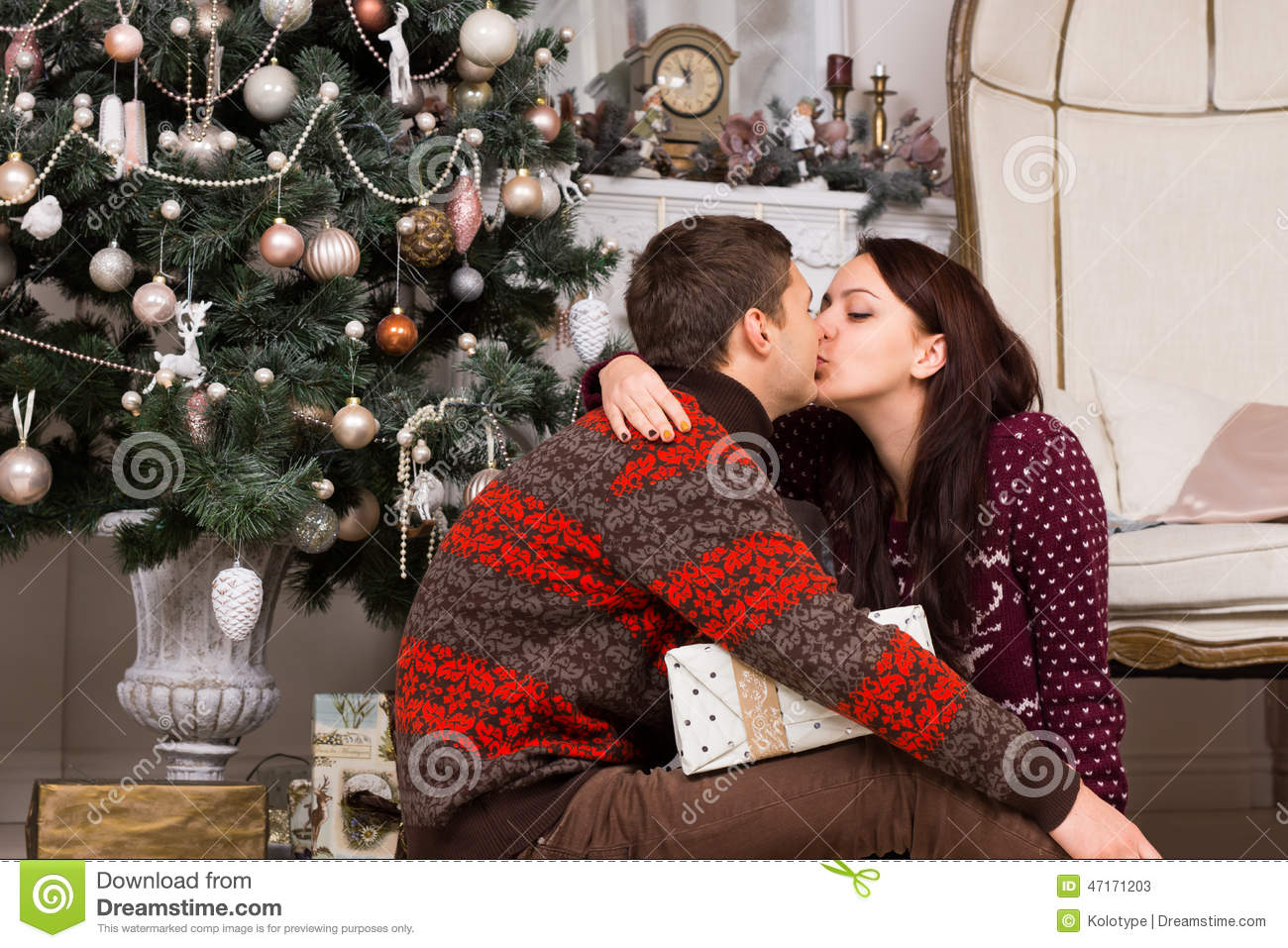 Romantic Couple Kissing In Front Of A Xmas Tree Stock Image - Image ...