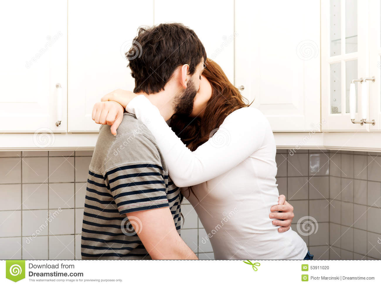 Romantic Couple Kissing In The Kitchen. Stock Photo - Image of ...