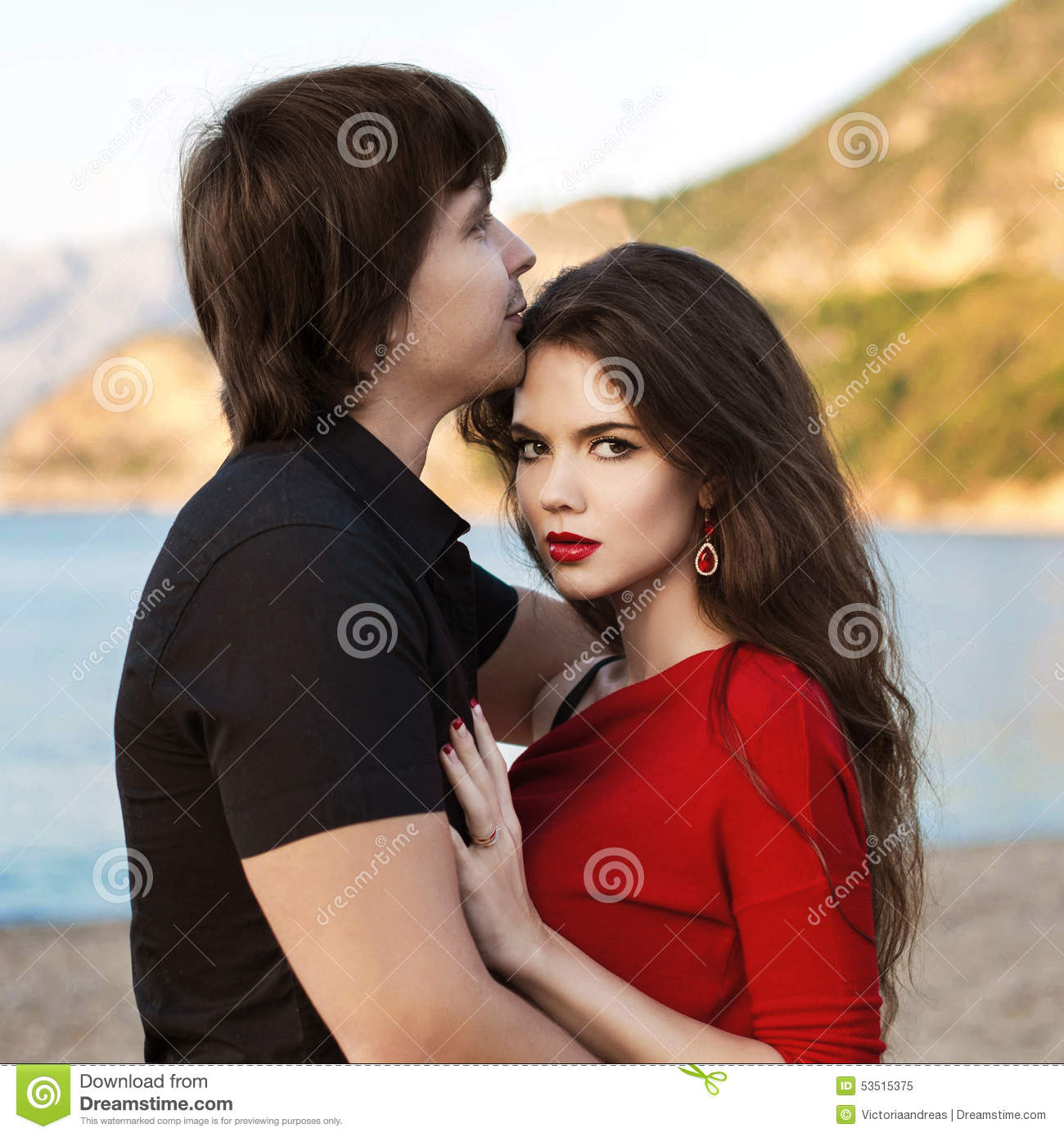Romantic Couple In Love At Beach Sunset. Newlywed Happy