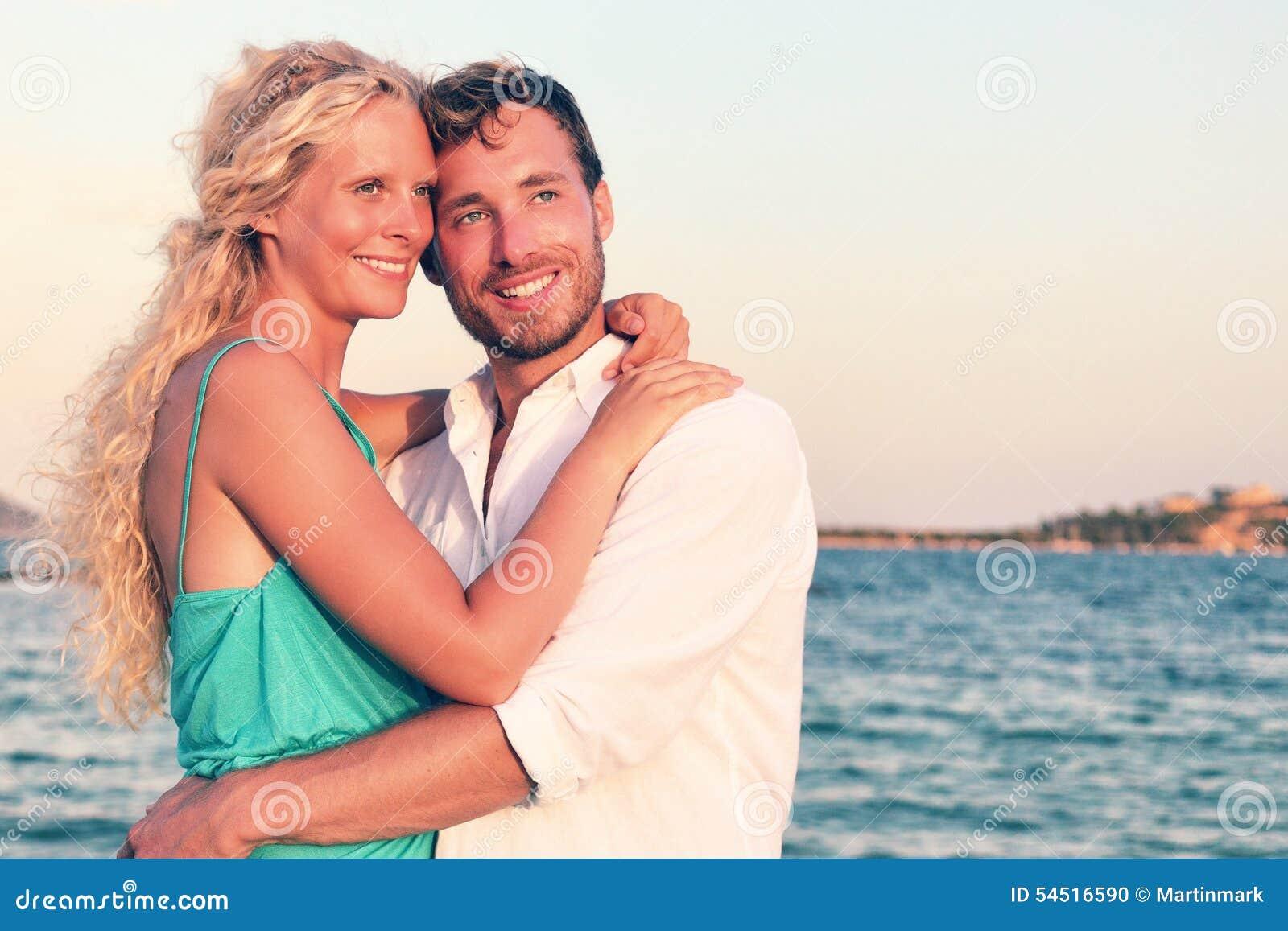 Romantic couple in love enjoying sunset at beach
