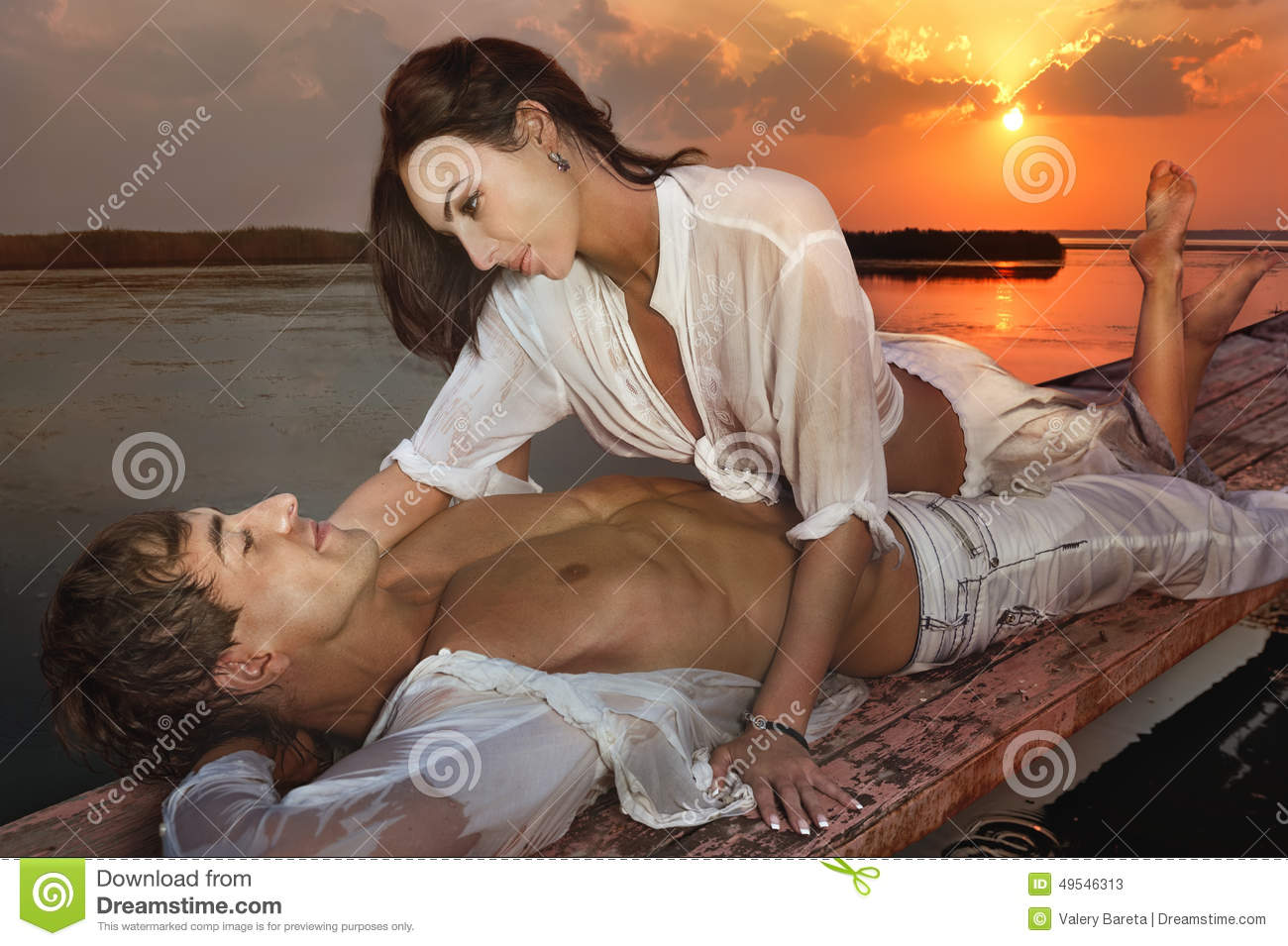 Romantic couple in love at sunset