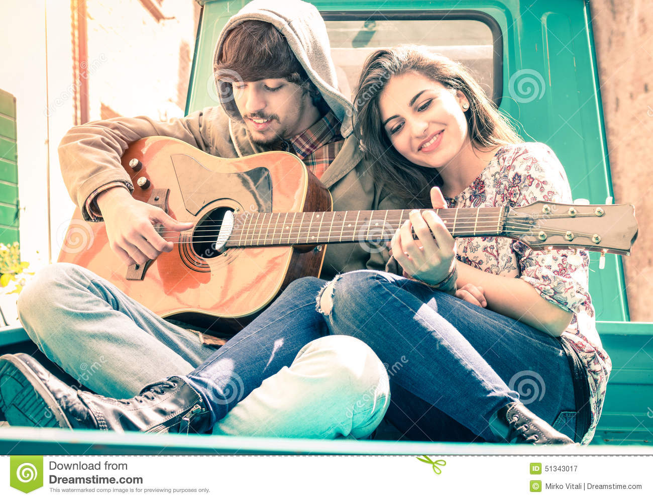 Love couple Guitar Wallpaper : Romantic couple Of Lovers Playing Guitar On Vintage Minicar Stock Image - Image: 51343017