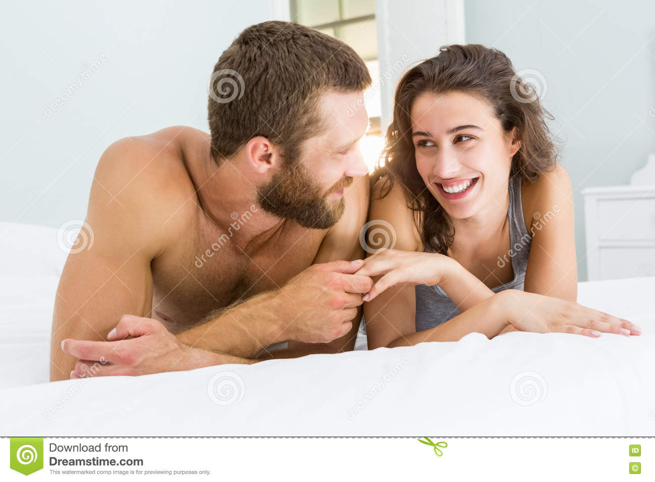 Romantic couple lying on bed Royalty Free Stock Image  Romantic Couple  Lying On A Bed. Bedroom Romantic Couple Images