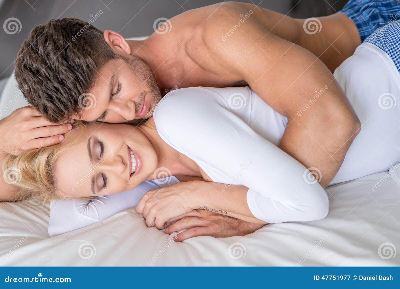 Royalty Free Stock Photo  Download Romantic Couple Lying On White Bed. Romantic Couple Lying On White Bed Stock Photo   Image  47751977