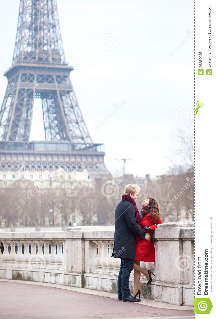 Romantic Couple Near The Eiffel Tower In Paris Royalty Free Stock ...