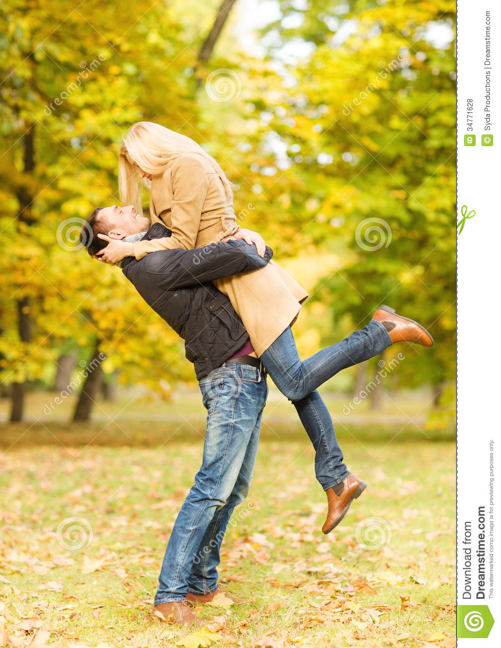 Romantic Couple Playing In The Autumn Park Royalty Free Stock     Romantic couple playing in the autumn park