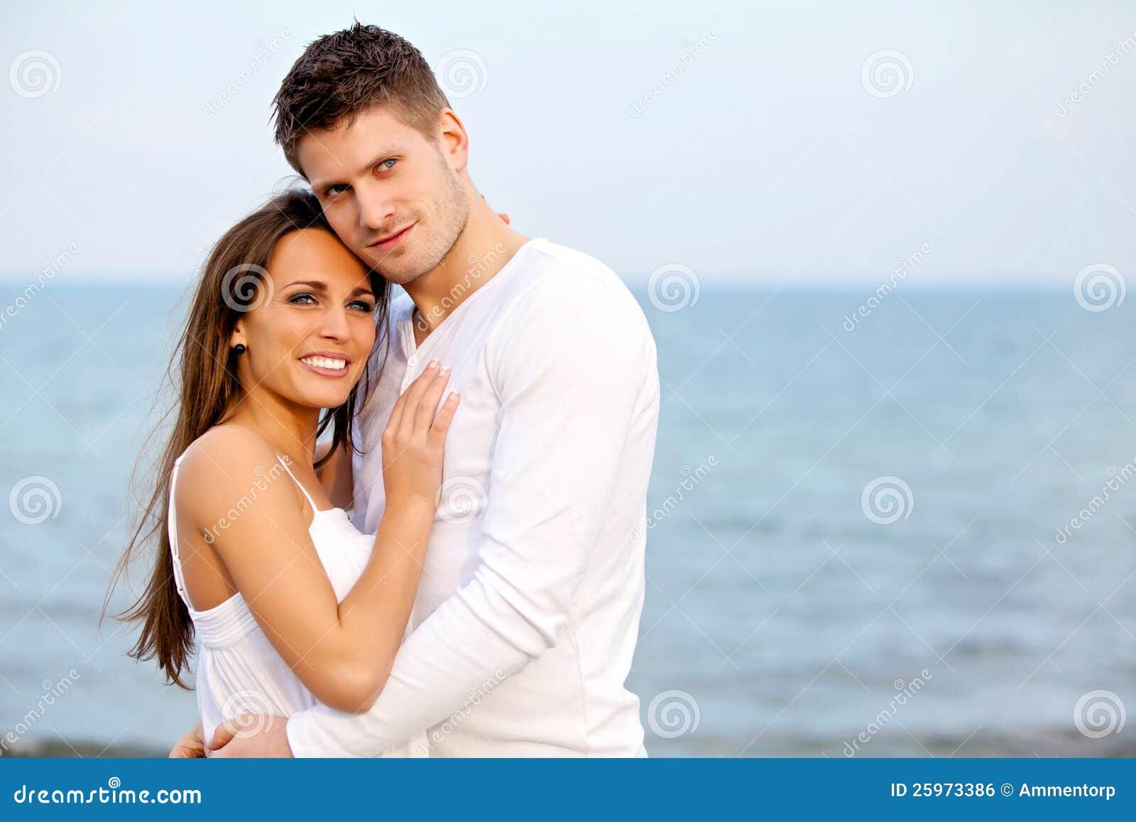 romantic couple posing at the beach stock photo image of light