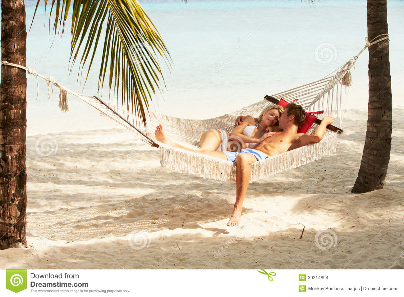 Romantic couple relaxing in beach hammock stock images for Best beach vacations in us for couples
