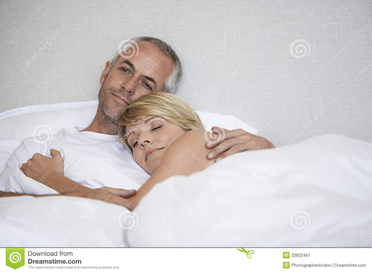 Romantic Couple Relaxing In Bed. Romantic Couple Relaxing In Bed Stock Image   Image  33832461