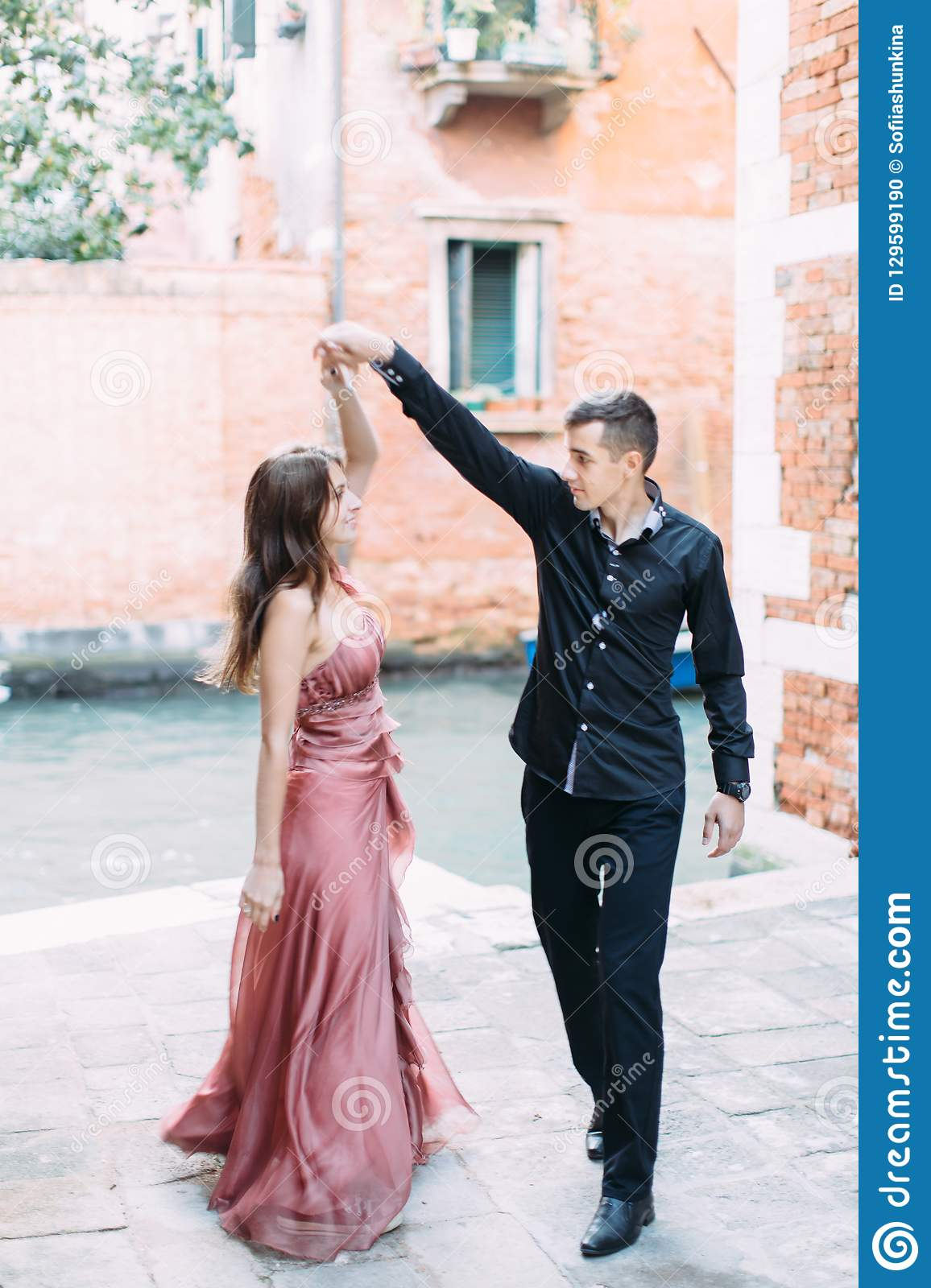 Romantic couple in Venice dancing and happy together. Italy, Europe.