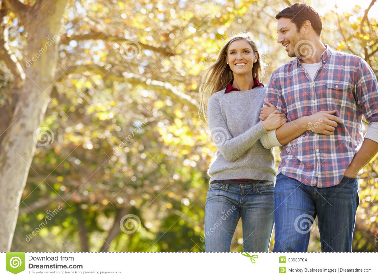 Romantic Couple Walking Through Autumn Woodland Stock ...