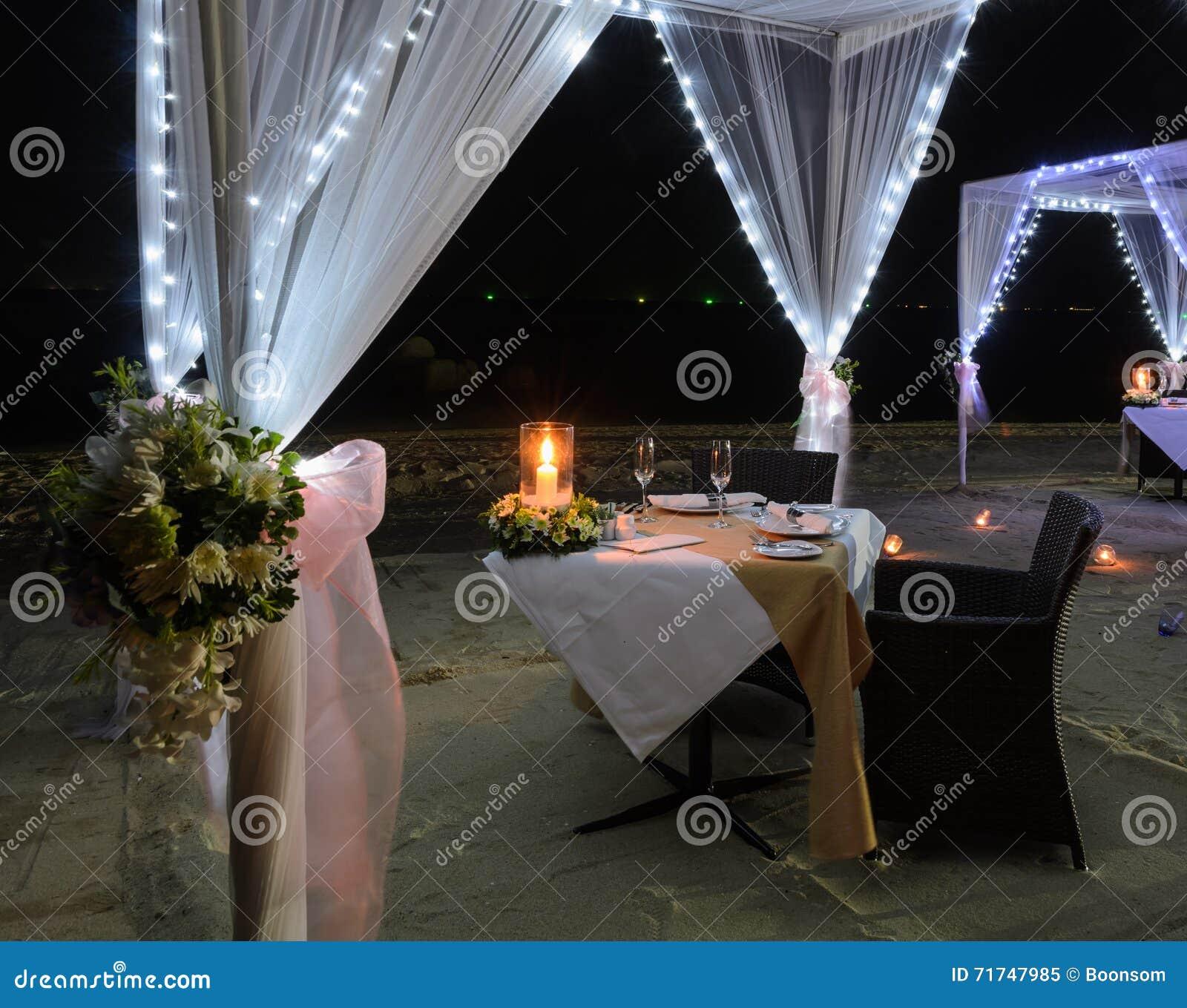 Romantic Dinner Setup On Beach At Night Stock Image