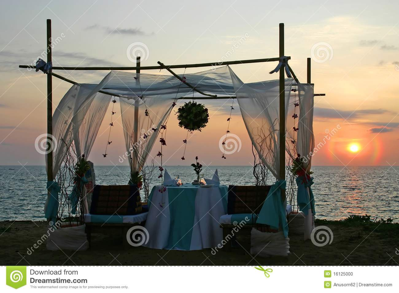 Romantic dinner sunset by the sea