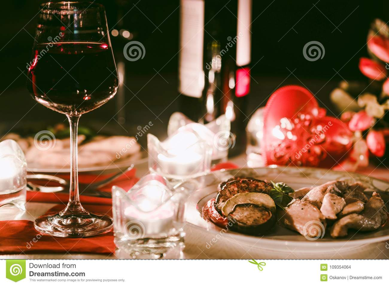 Diner Romantique Au Lit romantic dinner for two with wine,candles, flowers stock