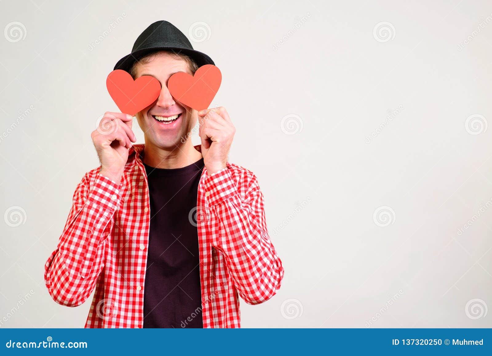 Romantic Guy Holds Valentine Cards  Be My Valentine