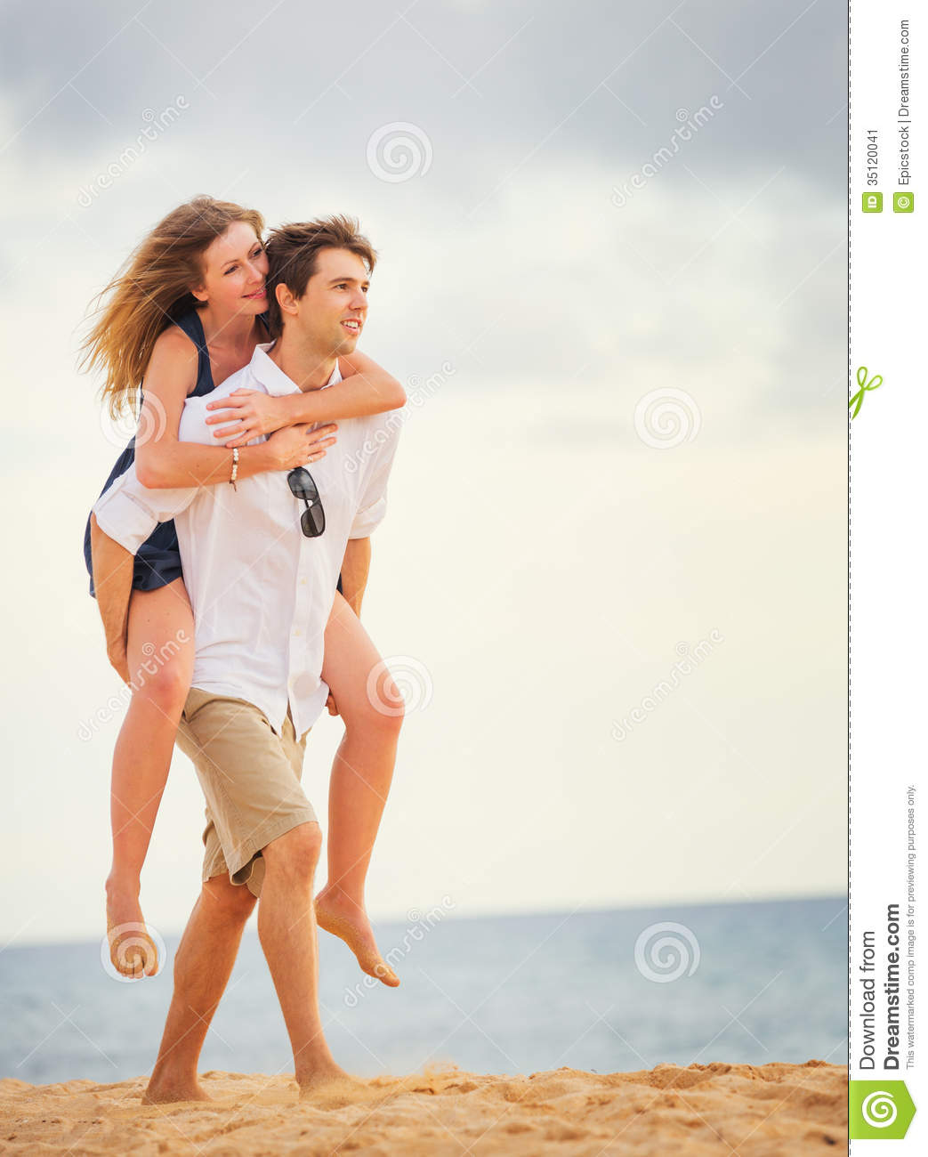 Romantic Happy Couple On The Beach At Sunset Stock Image