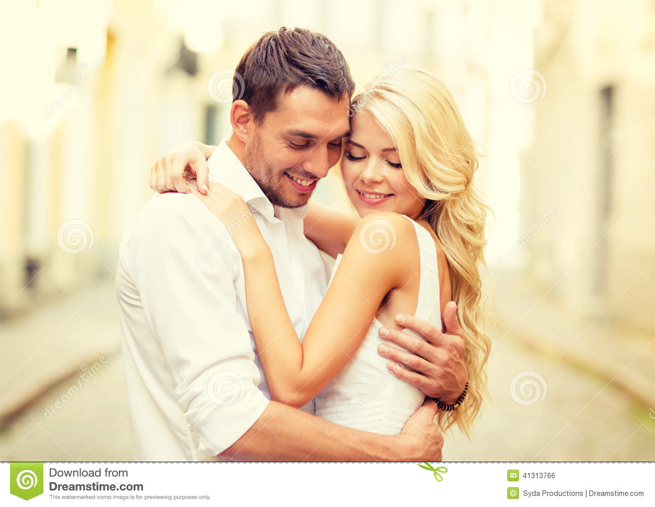 Romantic happy couple hugging in the street. Romantic Happy Couple Hugging In The Street Stock Photo   Image