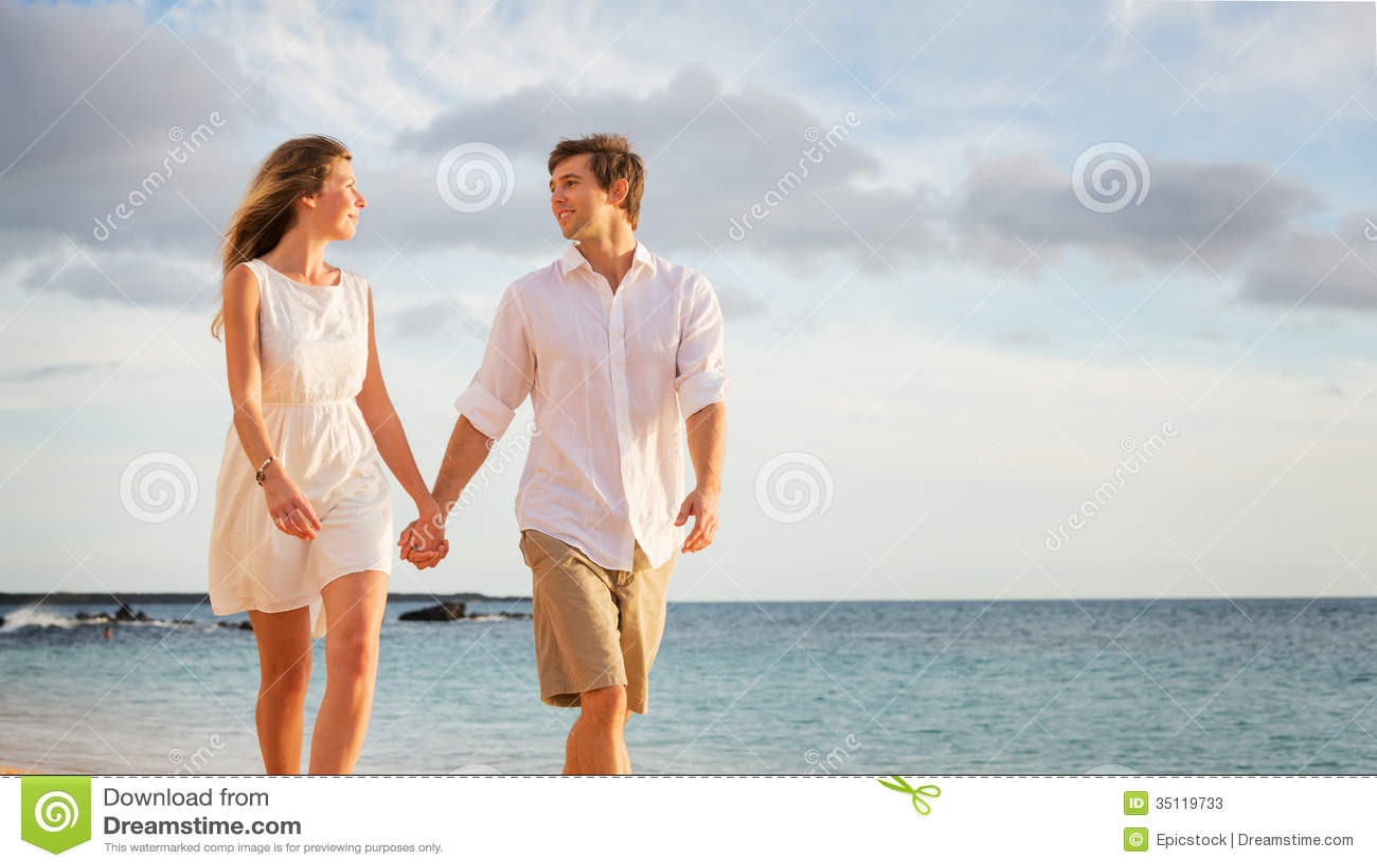 Stock Photos Romantic Happy Couple Walking Beach Sunset Smiling Holdin...
