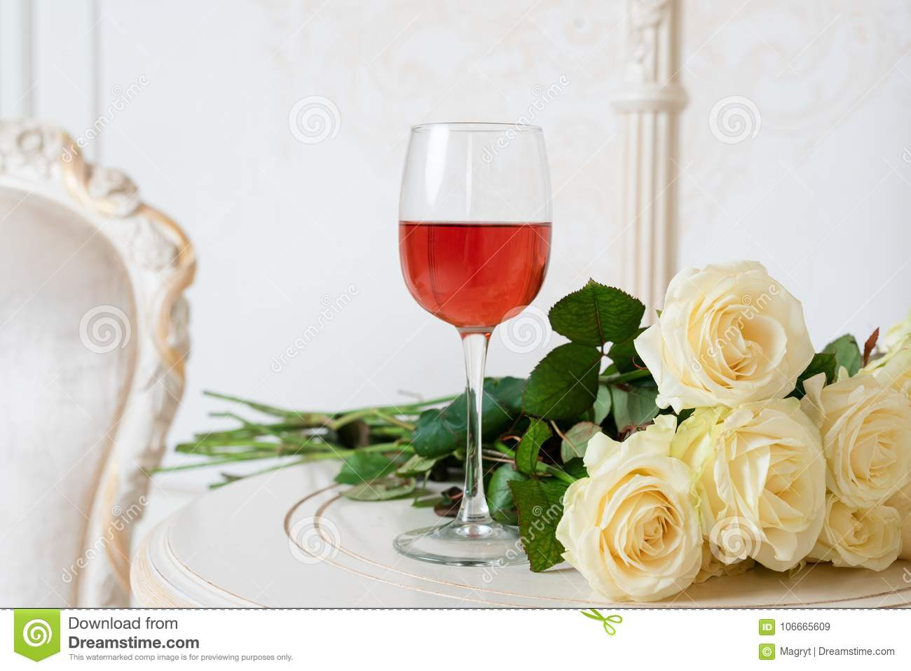 Romantic Holiday Composition With Wine Glass And Roses For