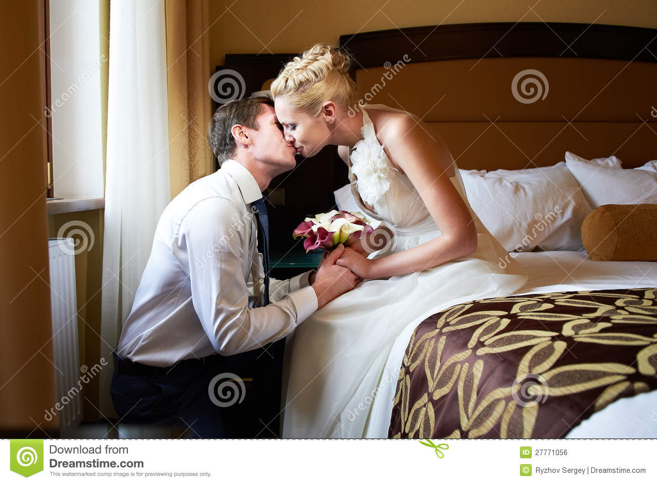 Romantic Kiss Bride And Groom In Bedroom Stock Photo - Image of ...
