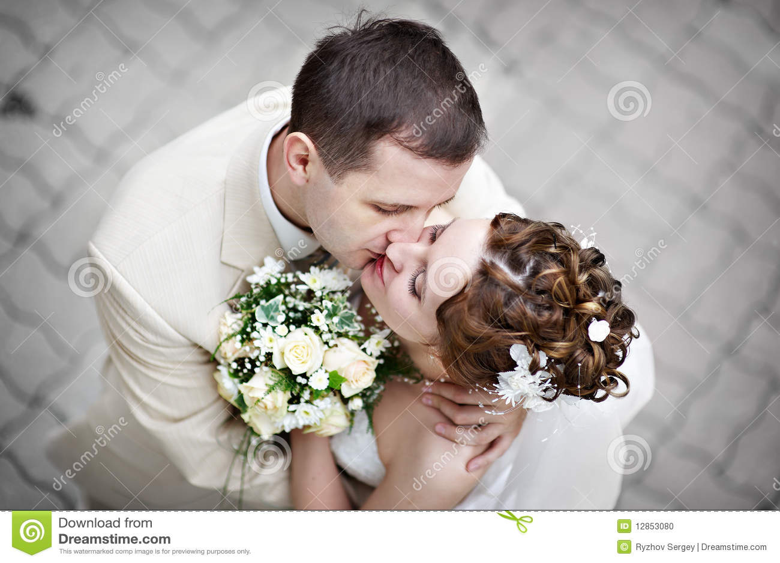 romantic kiss bride and groom at wedding walk stock photo - image