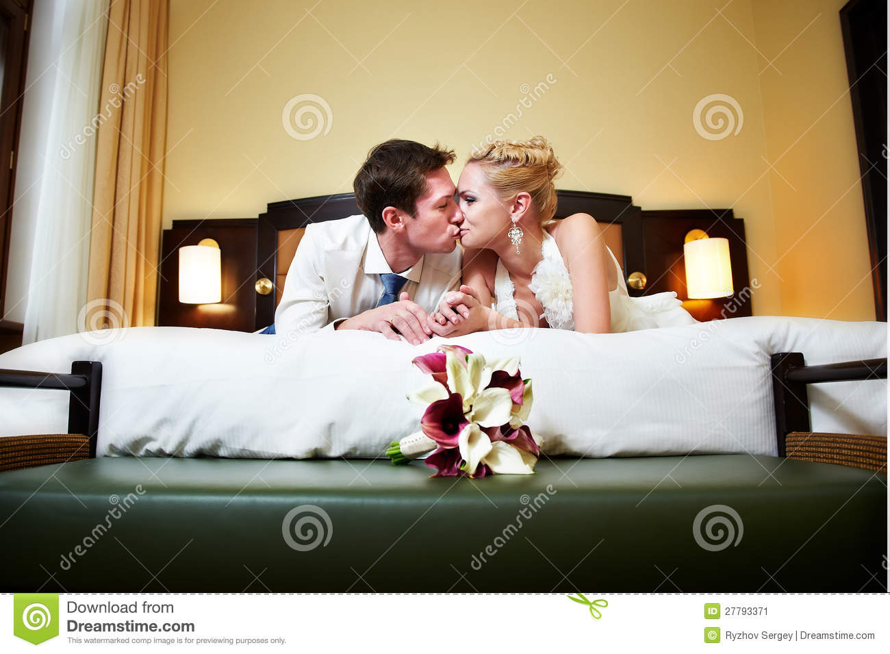 Romantic Kiss Happy Bride And Groom In Bedroom Stock Image