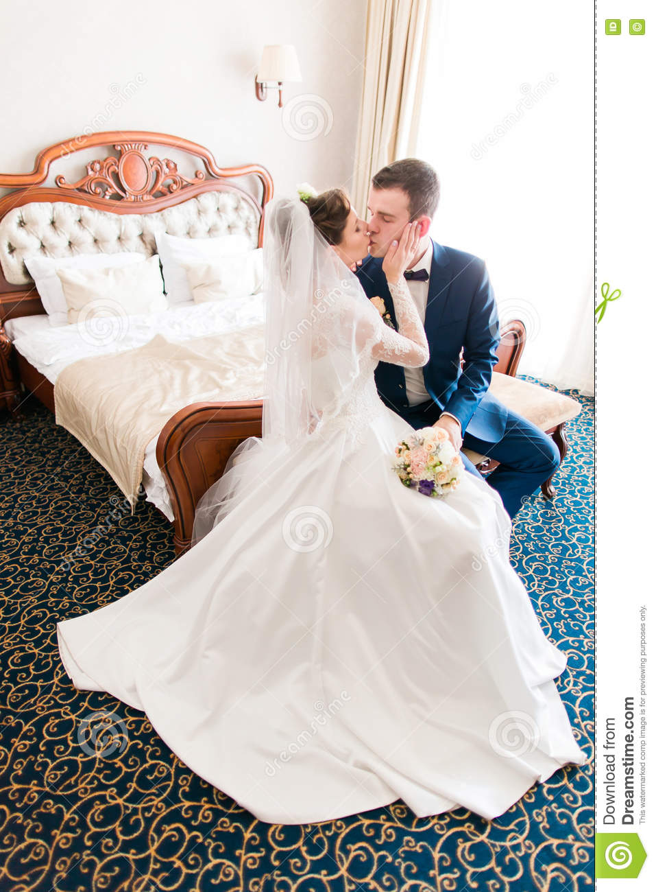 Romantic Kiss Happy Bride And Groom In Bedroom On Wedding Day Stock ...