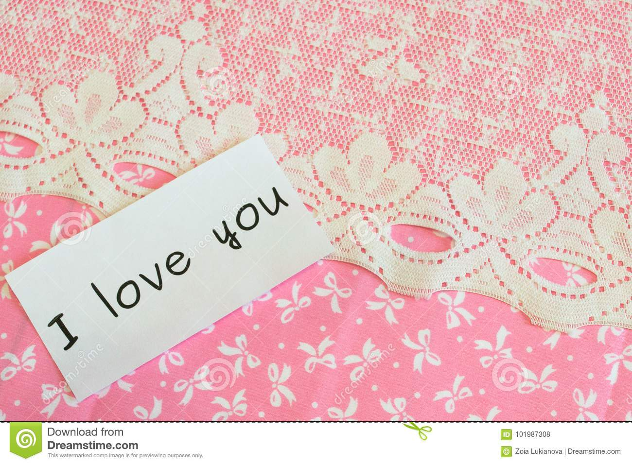 words  i love you  isolated on fabric background stock photo
