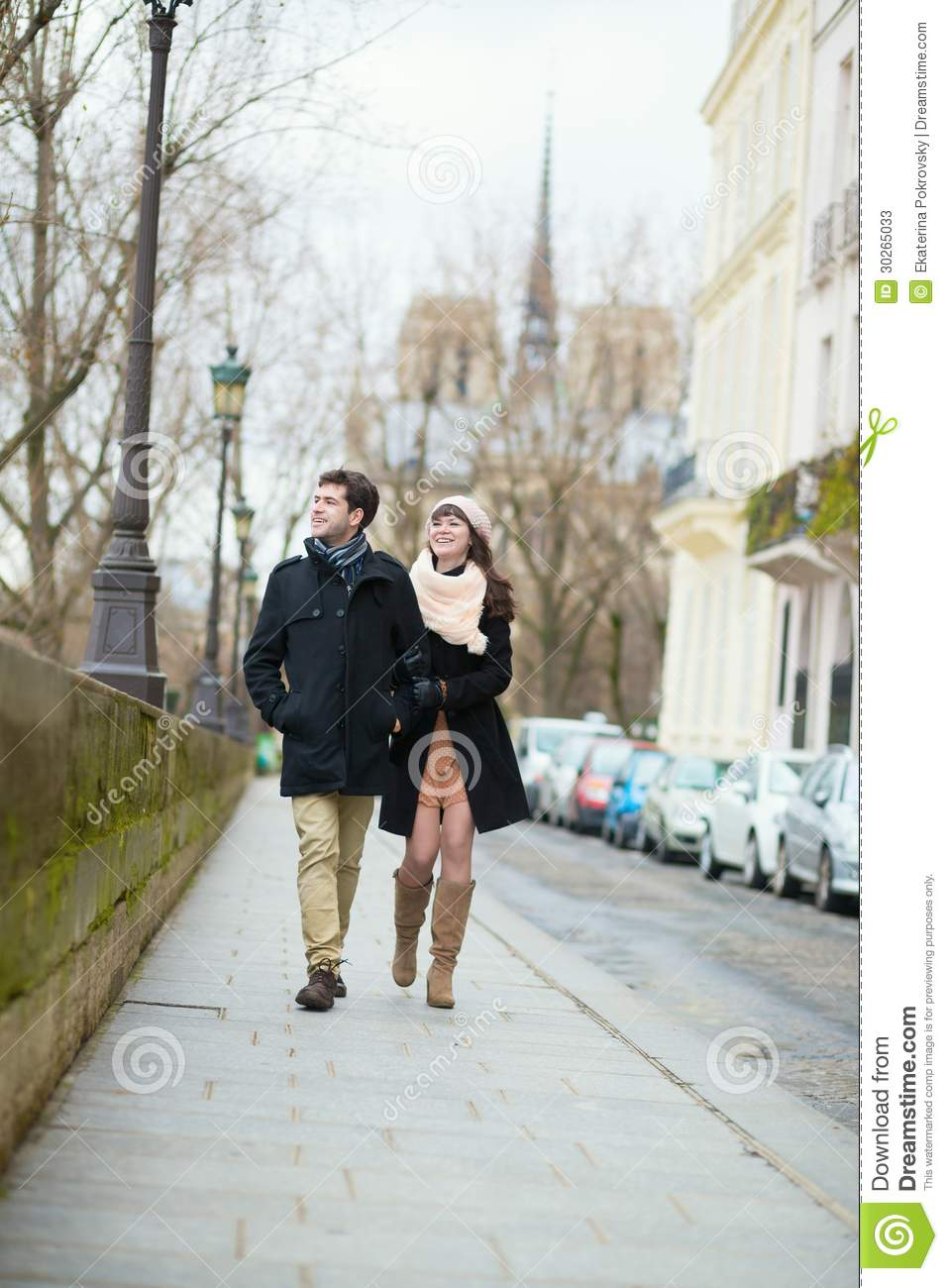 romantic couple walking together in paris stock photos
