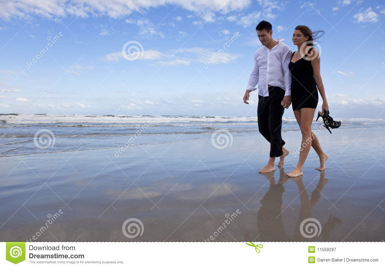 Woman walking on a beach royalty - Romantic Man And Woman Couple Walking On A Beach