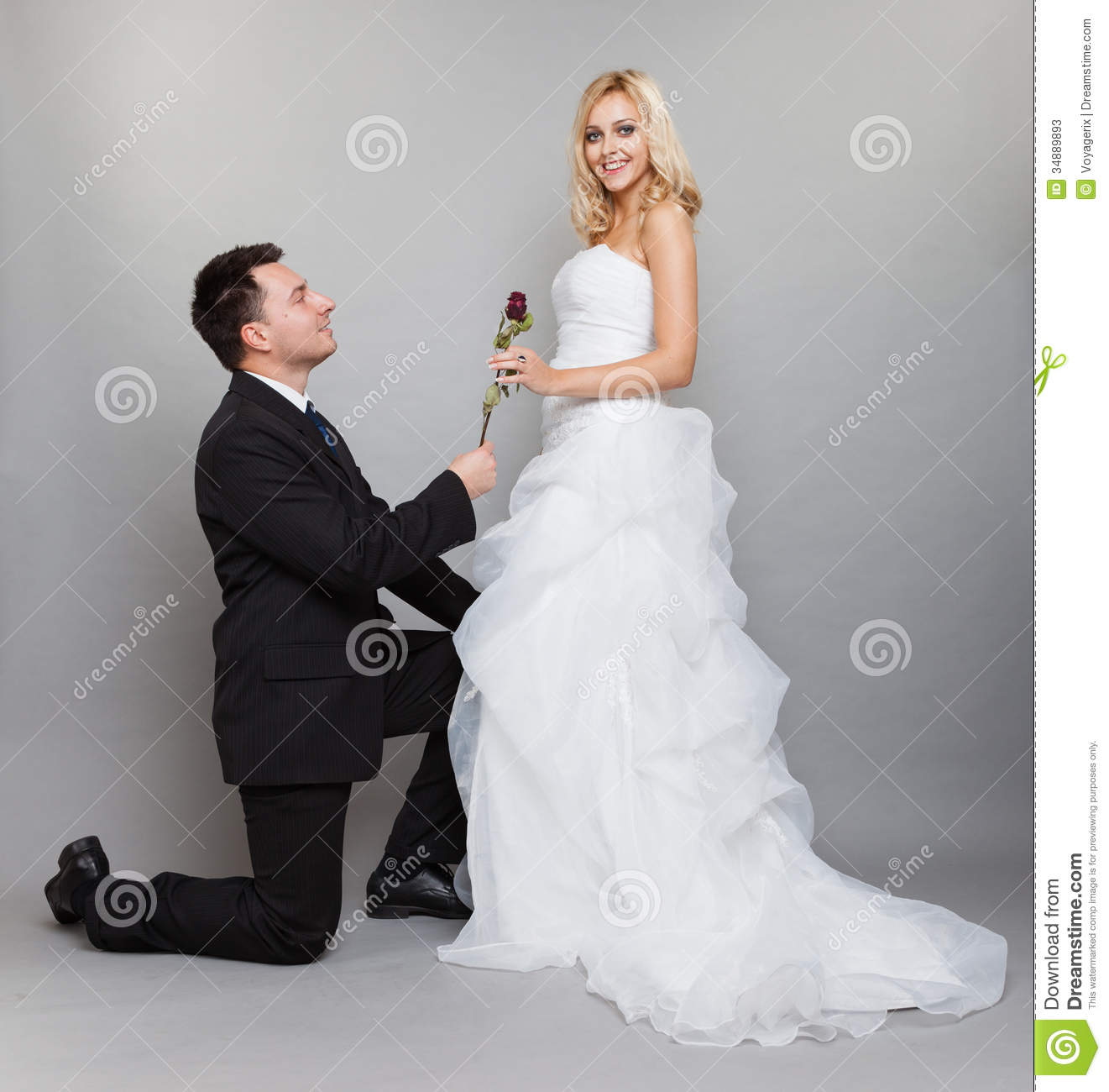 Romantic Married Couple Bride And Groom With Rose Stock